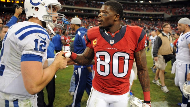Indianapolis Colts quarterback Andrew Luck (12) talks to Houston Texans wide receiver Andre Johnson (80) after the Colts' 27-24 victory, Sunday, November 3, 2013. Now the two men are teammates.
