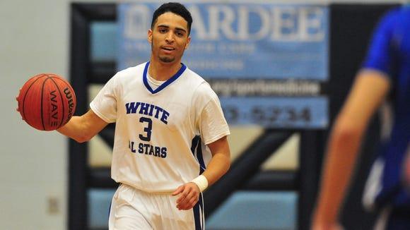 Asheville High senior Damon Scott (3) was the MVP of Saturday night's Blue-White All-Star boys basketball game at Enka.