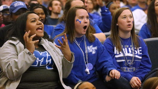 MTSU students (L to R) Vanessa Beard, Katie Hardy and Mallory Hardy react to the NCAA game against Syracuse during a watch party in the Student Union Building on Campus, Sunday March 20, 2016.