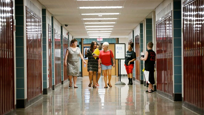 Families of incoming Broadway Academy students roam the halls during orientation. The structured event aimed to help ease apprehensions and help students better learn their schedule.