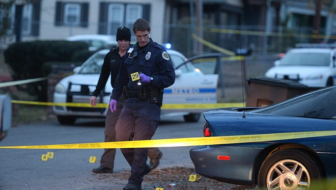 Police investigate a shooting on St. Louis Street in north Nashville on Sunday, Nov. 27, 2016.