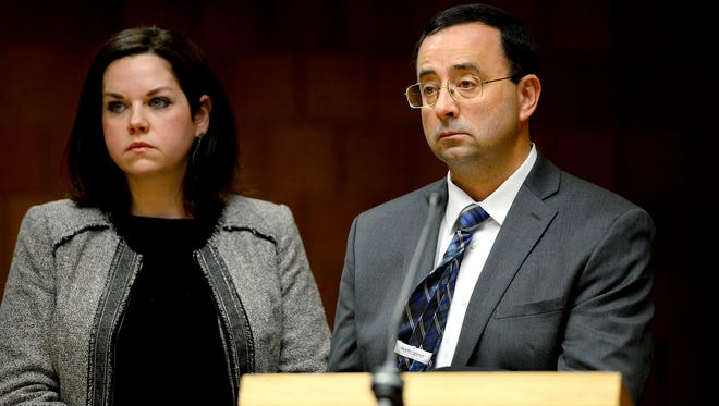 Former MSU doctor Larry Nassar appears for a pre-trial examination with one of his attorneys Shannon Smith in Ingham County District Court Thursday Dec. 8, 2016 in Mason.