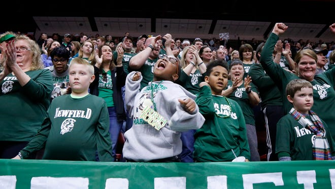 Newfield fans cheer for the boys basketball team during its Class D state semifinal victory last season at Floyd L. Maines Veterans Memorial Arena in Binghamton. The Trojans are ranked second in Class D by the New York State Sportswriters Association this week.