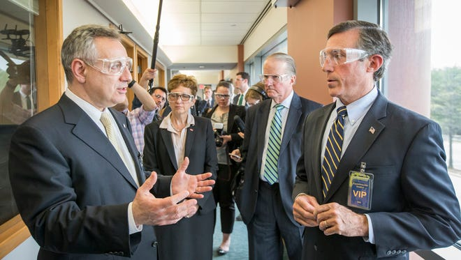 Dennis Assanis, president of the University of Delaware, talks with Gov. John Carney during a tour of a planned innovation incubator at DuPont Co.'s Experimental Station in Alapocas on Monday afternoon.