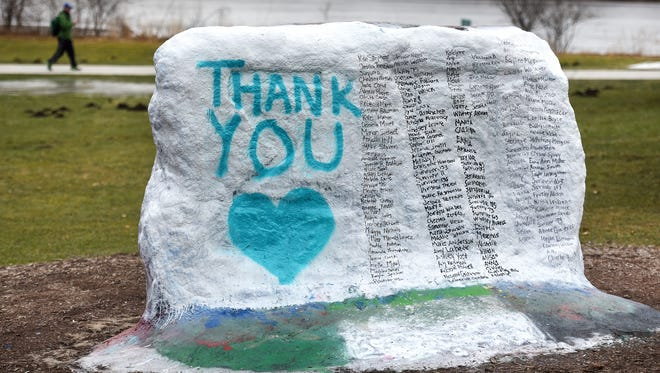 """The Rock on Michigan State University's campus is photographed on Thursday, Jan. 25, 2018, and is painted to say """"thank you"""" and includes the names of everyone who gave victim impact statements during the Larry Nassar sentencing hearing."""