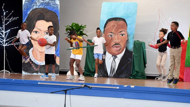 Alexander Elementary third graders exercise during their tribute to the first Black first lady of the United States during the school's Black History Month program, Thursday, Feb. 22.