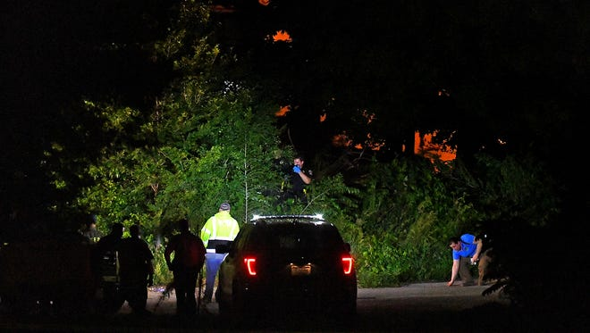 Officials investigate the scene where a body was reportedly found in brush along Rail Trail County Park near Good Time Ice, which is located at Manor and Church Streets in York City, Wednesday, May 30, 2018. Dawn J. Sagert photo
