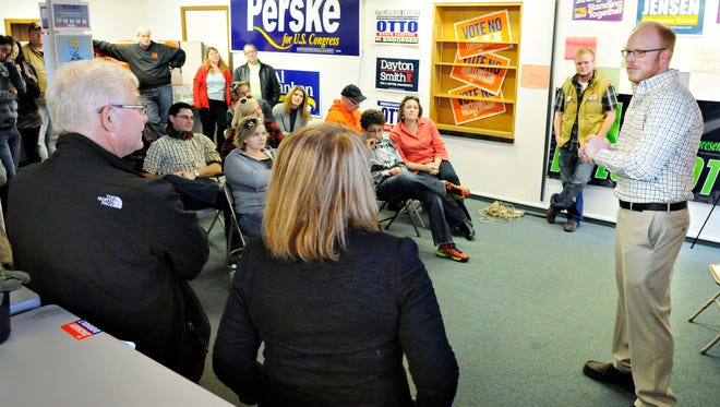 House District 14B Rep. Zachary Dorholt talks with a group of volunteers at the St. Cloud DFL office before they head out door-knocking Sunday.