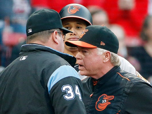 Baltimore Orioles manager Buck Showalter, right, talks with first base umpire Sam Holbrook (34) as Manny Machado looks on during the first inning of a baseball game, Tuesday, May 2, 2017, in Boston. (AP Photo/Michael Dwyer)