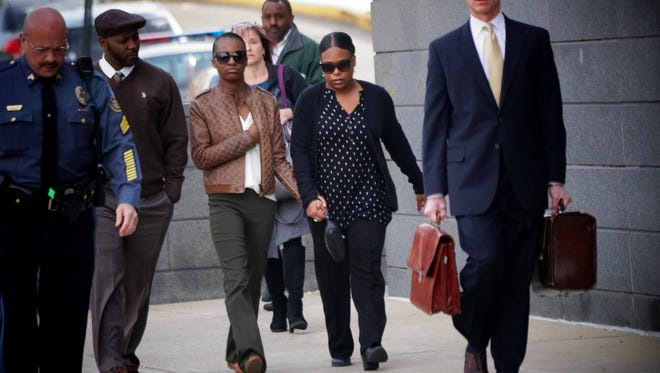 Surrounded by family, her attorney and security, 17-year-old Trinity Carr walks into the New Castle County Courthouse in Wilmington on Monday morning to face charges of criminally negligent homicide, a felony, and third-degree criminal conspiracy, a misdemeanor, in the death of her Howard High School classmate 16-year-old Amy Inita Joyner-Francis.