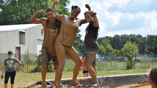 Robert Werner, Brittany Werner and Rylee Savage, 13, all of Franklinville pose for a photo at the finish line during the 10th Annual Bill Bottino Mud Run for Cancer.
