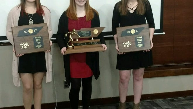 Hardin County's Ashley Channell (center) won the Miss Bowler of the Year award on Thursday. Hardin County's Faith Welch (right) was a finalist.