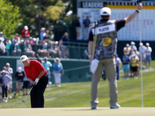 Jack Nicklaus watches his putt on the 9th hole during