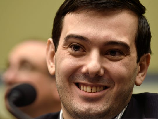 In this Feb. 4, 2016, file photo, Pharmaceutical chief Martin Shkreli smiles on Capitol Hill in Washington during the House Committee on Oversight and Reform Committee hearing on his former company's decision to raise the price of a lifesaving medicine.