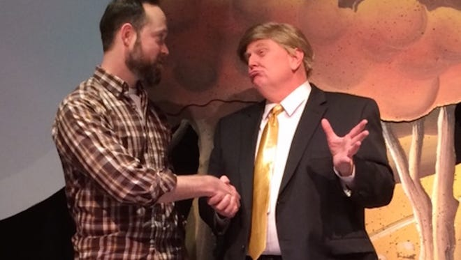 "Craig Petersen plays a ""typical"" Iowan voter and Greg Millar plays a presidential candidate named Ronald Blunt in ""Caucus! The Musical"" at the Des Moines Civic Center's Stoner Theater."