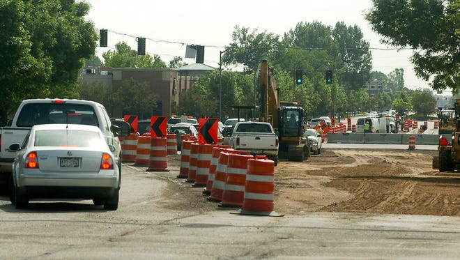 Traffic makes its way through the construction at the intersetion of Harmony Road and College Ave. Wednesday June 9, 2010.
