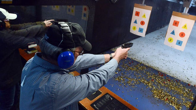 Fort Collins Coloradoan reporter Kevin Duggan is pictured as he completes a concealed-carry class at the Front Range Gun Club in Loveland Saturday March 9, 2013. The number of applications from people seeking to obtain a concealed weapons permit in Colorado has nearly doubled this year compared with 2015.