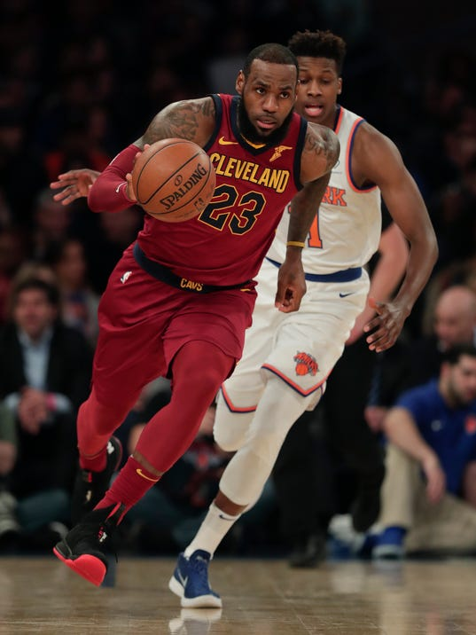 Cleveland Cavaliers forward LeBron James (23) drives downcourt past New York Knicks guard Frank Ntilikina (11) during the first quarter of an NBA basketball game, Monday, April 9, 2018, in New York. (AP Photo/Julie Jacobson)