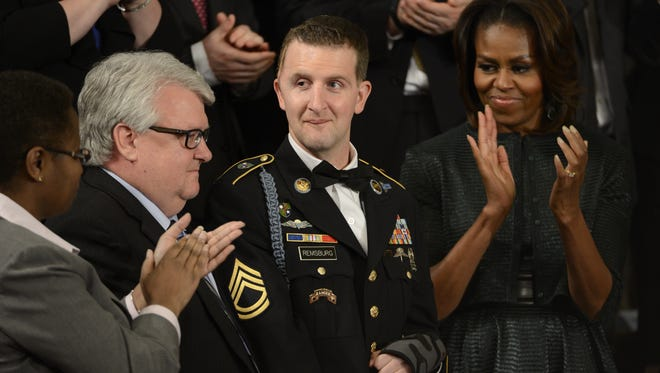 U.S. Army Ranger Sgt. 1st Class Cory Remsburg is recognized by President Barack Obama during Obama's State of the Union speech in 2014. First lady Michelle Obama stands next to him. Remsburg's father, Craig, is at left.