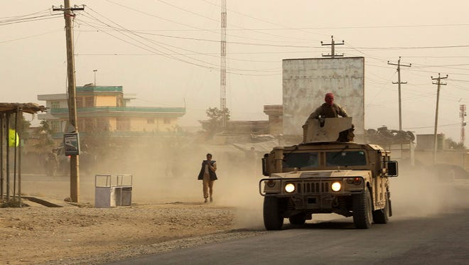 Afghan security forces travel in a Humvee vehicle, as battles were ongoing between Taliban militants and Afghan security forces, in Kunduz, capital of northeastern Kunduz province on Sept. 28, 2015.