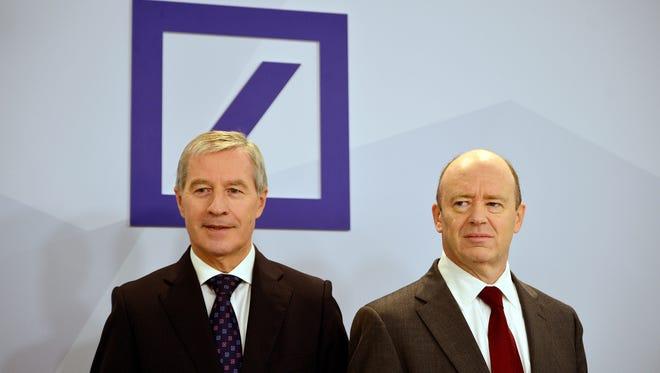 Deutsche Bank co-Chairmen John Cryan (R) and Juergen Fitschen (L) arrive to speak to the media at Deutsche Bank headquarters on October 29, 2015 in Frankfurt, Germany.