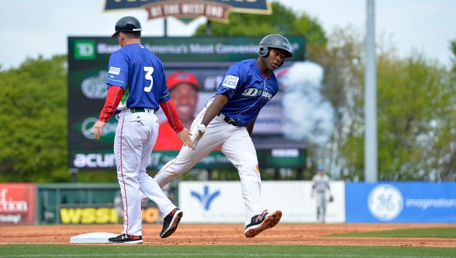 Greenville's Josh Ockimey rounds third tagging manager Darren Fenster after hitting a 2nd inning home run. The Greenville Drive hosted the Asheville Tourists Sunday, April 10, 2016  at Fluor Field.