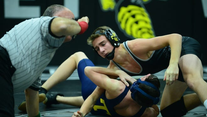 Senior Gabe Welch (top) is one of the key returning wrestlers for Hackley this season.