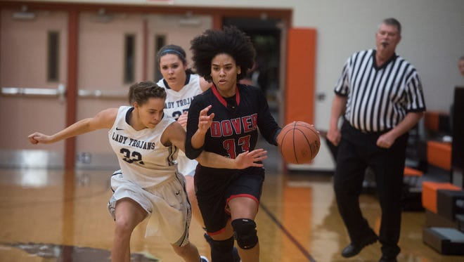 Dover's Rajah Fink fends off an attack by Chambersburg's Ariana Burke during play on Thursday Dec. 29, 2016. Dover defeated Chambersburg 42-25.