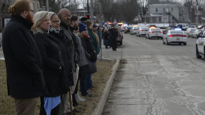 More than 50 people gathered along Third Street to view the funeral procession for Patrolman Dave Skaggs.