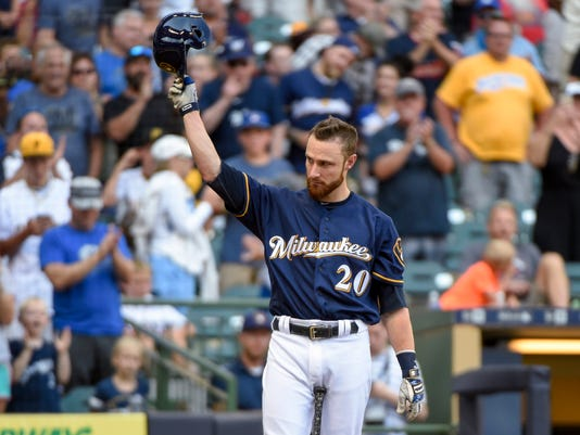 Milwaukee Brewers' Jonathan Lucroy tips his cap after getting a standing ovation from fans while pinch-hitting during the eighth inning of a baseball game against the Pittsburgh Pirates on Sunday, July 31, 2016, in Milwaukee. Lucky stopped a trade to the Cleveland Indians earlier in the day. (AP Photo/Benny Sieu)