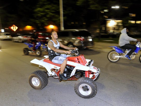 People ride their ATVs and dirt bikes across Gratiot