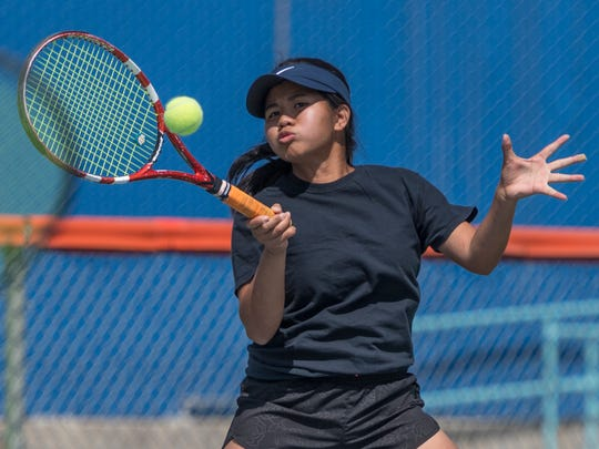 College of the Sequoias women's tennis player Marah Pinquian practices on Tuesday, April 17, 2018. She and three teammates will play in matches in state playoffs.