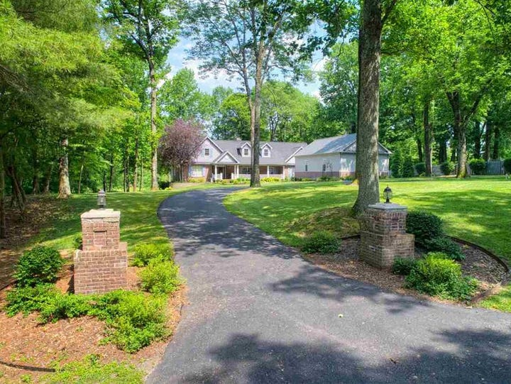 Situated on a two-acre lot on Kahre Lake in a private