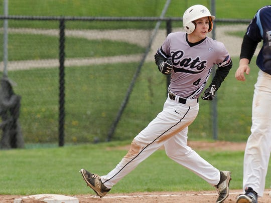 Reaching third base for Plymouth is Michael Wischer (4) during Monday's game against Livonia Stevenson.
