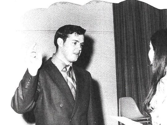 This 1971 photo shows Dan Klaich being sworn in as the student body president of the University of Nevada, Reno by Frankie Sue Del Papa swearing me in as ASUN President.