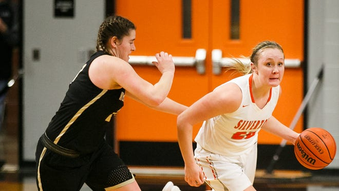 Silverton's Maggie Roth, handling the ball in the Foxes' first-round 5A state playoff victory over Hermiston on March 2 at Silverton High School, is the Mid-Willamette Conference Player of the Year.
