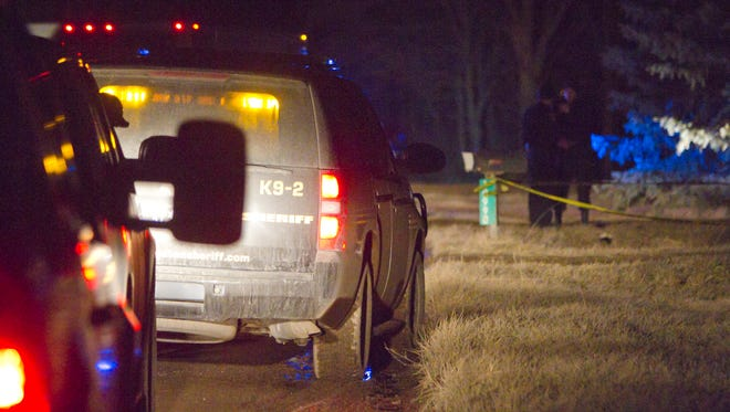 Livingston County sheriff's deputies investigate the scene of a possible murder-suicide in the 10000 block Sargent Road in Handy Township on Friday night.