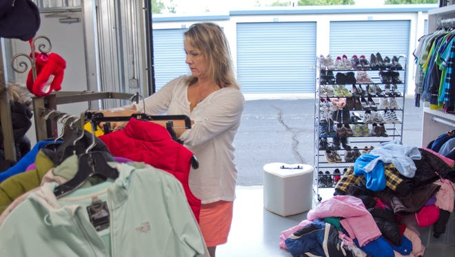 "Best Self Storage owner Beth Krause has just opened Foster Closet, offering free clothing to foster families, distributing donated clothing at a ""storefront"" in a storage unit in the Genoa Township facility."