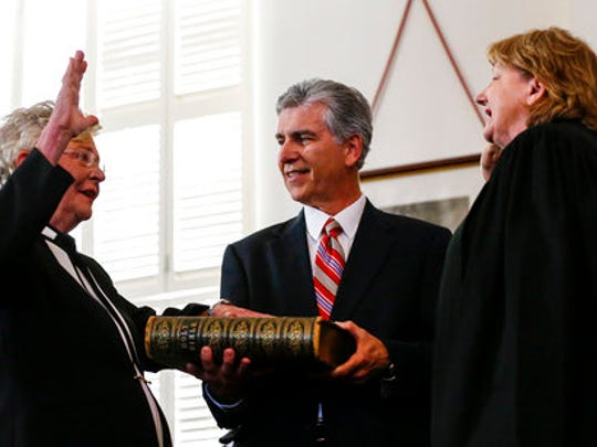 Kay Ivey, left, takes the oath of office as Governor of Alabama as she is sworn in by Acting Chief Justice, Lyn Stuart, Monday, April 10, 2017, in Montgomery, Ala.