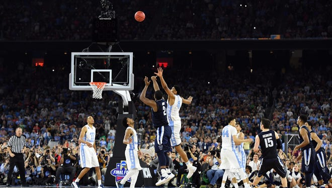 Villanova Wildcats forward Kris Jenkins hits the game-winner while North Carolina, including his brother, Nate Britt, watches.