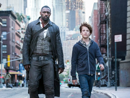 "Idris Elba (left) and Tom Taylor star in ""The Dark"