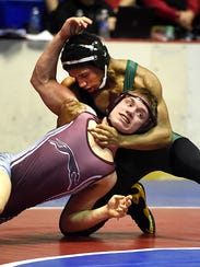 Chandler Olson of Shipensburg wrestles Tyshawn White