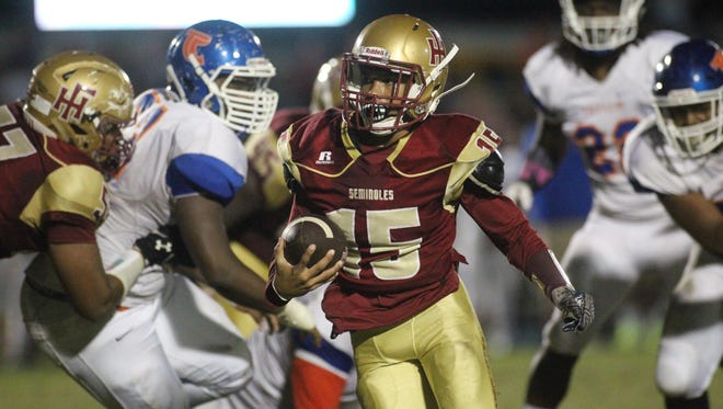 Florida High quarterback Bryson Hill runs during a win over Taylor County two years ago. The Seminoles won a district title in a tiebreaker Monday.