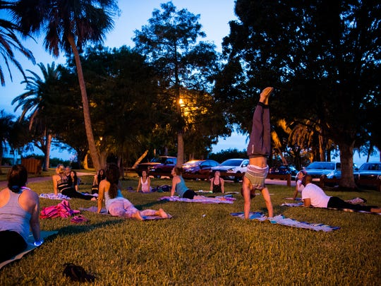 The Healing House hosts a family yoga gathering Friday, July 14, 2017, at Shepard Park in Stuart. The Healing House aims to help children, teens and adults learn self-regulating methods to reduce stress, improve optimal performance and increase personal growth and wellness, according to its website.