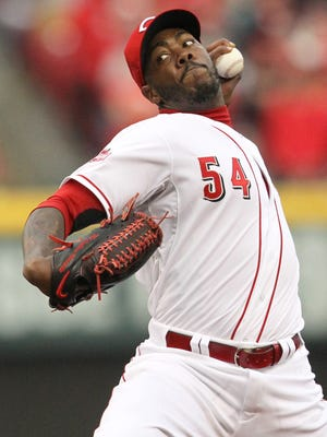 Reds closer Aroldis Chapman delivers during the 9th inning of the 5-2 Opening Day win against the Pittsburgh Pirates.