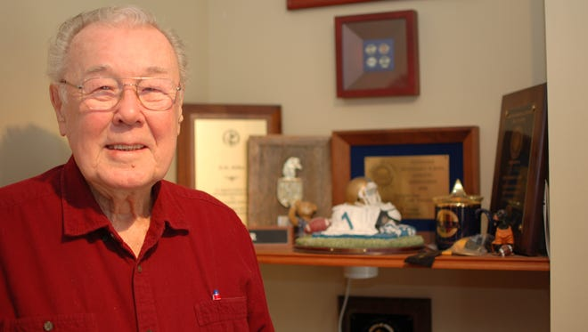 D.M. Miller, 91, of Knoxville, with some of his educator and coaching awards.