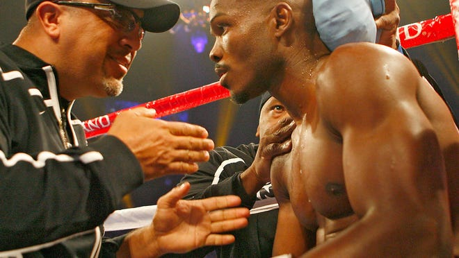Trainer Joel Diaz coaches Timothy Bradley between rounds during his fight against Joel Casamayor at the MGM Grand Casino in Las Vegas in November 2011.