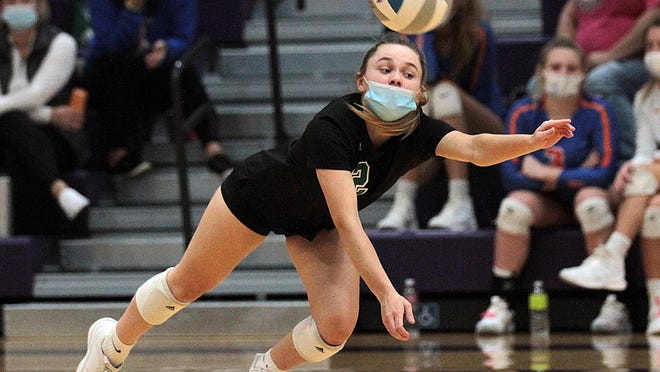 Caylena Briggs of Mendon dives to attempt to keep a ball in play at Bronson on Wednesday evening.