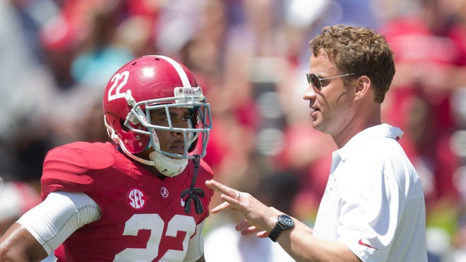 Alabama offensive coordinator/quarterbacks coach Lane Kiffin talks to wide receiver Christion Jones during the Crimson Tide's spring game.