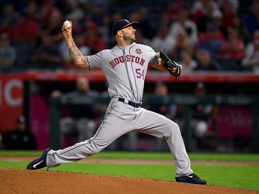 Houston Astros starting pitcher Mike Fiers throws during the first inning of the team's baseball game against the Los Angeles Angels, Wednesday, Sept. 13, 2017, in Anaheim, Calif. (AP Photo/Mark J. Terrill)